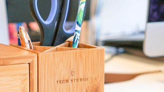 Tech Studio logo etched into a pencil holder